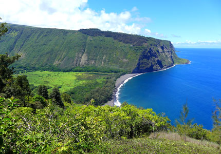 Explore the sights of Waipio Valley on an ATV tour, one of GAYOT's Top 10 Things to Do on the Big Island of Hawaii