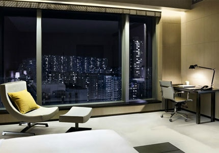A guest room at east Hong Kong, one of GAYOT's Top 10 Business Hotels in Hong Kong