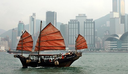 Traditional Chinese junks are a common sight in Hong Kong's Victoria Harbour