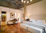 A guest room at Relais Santa Croce, one of GAYOT's Top 10 Hotels in Florence