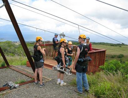 Adventure seekers preparing to zipline Mountain Outpost