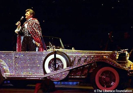 Liberace on stage with his Crystal Roadster