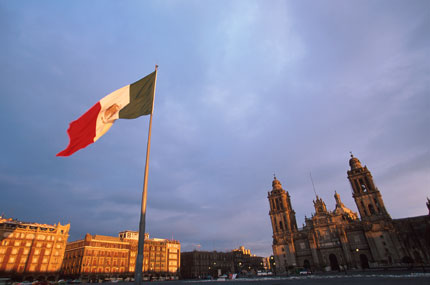 The Cathedral of Mexico City and historical buildings surround the Zocalo, which is the main square in Mexico City D.F.