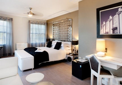 A guest room at Room Mate Waldorf, one of GAYOT's Top 10 Cheap Hotels in Miami/South Florida