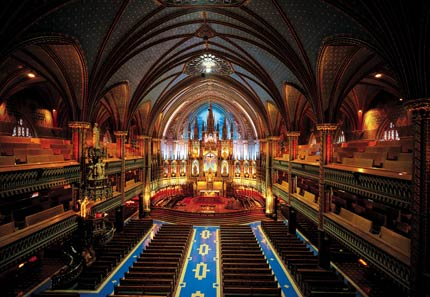 The ornate altar and high, vaulted ceilings of Notre Dame Basilica in Montréal