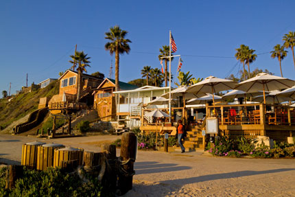 Watch the sunset while you dine on the beach at The Beachcomber at Crystal Cove