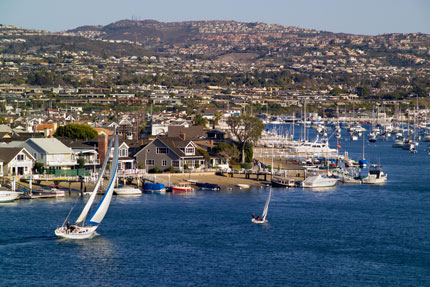 Newport Harbor is popular with boaters due to its sunny weather and scenic views