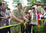 Ribbon-cutting and house dedication by Habitat for Humanity Indonesia and PT Anek Tambang Tbk