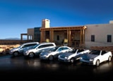 New Mexico's Encantado hotel with a fleet of Mercedes-Benz cars parked outside