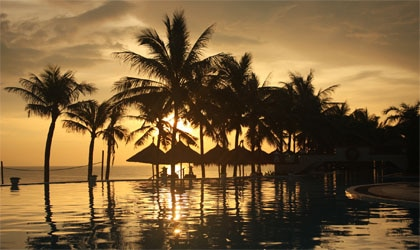 The sun sets over HoiAn Beach Resort in Vietnam