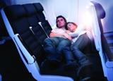A couple rests on the new Air New Zealand Skycouch seats