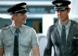 Flight crew members clad in body paint on the Air New Zealand commercial