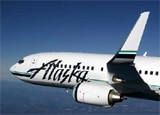 Fly aboard a Boeing 737-800 aircraft from Seattle to Maui