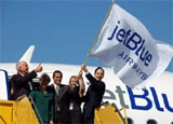 Los Angeles Mayor Antonio Villaraigosa, center and others celebrate the addition of JetBlue service to LAX