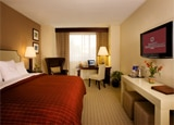 A room with a king-sized bed at the newly opened Sheraton Phoenix Downtown Hotel
