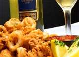 Earn frequent-flyer credits when ordering at more than 9,000 establishments in the U.S. and Canada through Southwest Airlines' Rapid Rewards Dining program, like Charlie's Trio in Los Angeles, pictured with their Calamari Fritti