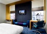 An aloft room with a king-sized bed