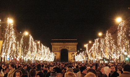 Revelers gather on the Champs-Elysees to ring in the New Year in Paris, France