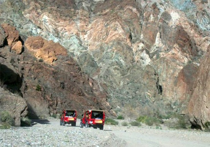 Hop on a red Jeep with Desert Adventures Eco-Tours, one of GAYOT's Top 10 Things to Do in Palm Springs