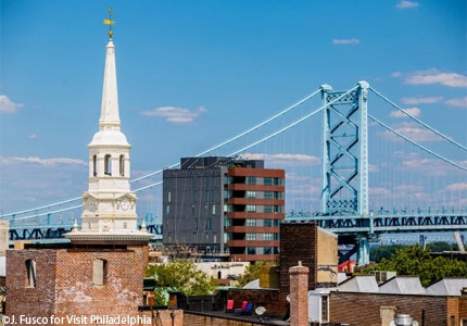 The Christ Church steeple and Benjamin Franklin Bridge in Philadelphia's Old City neighborhood