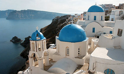 A view of the seascape from mountainside Santorini, one of our Top Romantic Destinations Worldwide