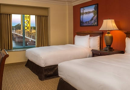 A guest room at Embassy Suites by Hilton Sacramento Riverfront Promenade in California
