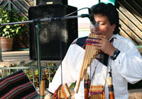 A musician plays a pan flute at El Mercado in San Antonio