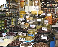An abundance of edible goods is displayed at the municipal market