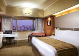Unwind at the Mandarin Orchard Hotel in Singapore