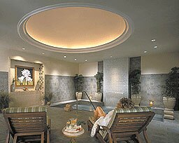 The women's lounge with a whirlpool, sauna, and steam room at The Spa at The Sanctuary at Kiawah Island Golf Resort