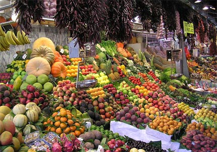 Local residents of Barcelona come to La Boqueria Market for a variety of fresh fruits and vegetables, breads, cheeses and meats