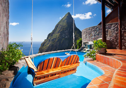 A guest room with a private pool swing at Ladera Resort on St. Lucia