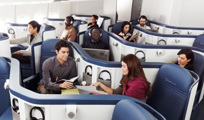 Passengers enjoying Delta's spacious BusinessElite seating