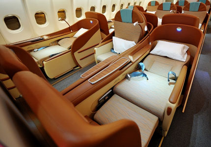 Oman Air offers a 77.5-inch long, lie-flat Business Class seat with an electrically-controlled backrest and leg rest