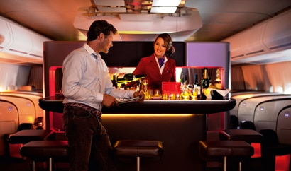 Upper Class passengers are invited to enjoy a drink and chat with fellow travelers at Virgin Atlantic's onboard bar