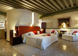 A guest room at Ruzzini Palace, one of GAYOT's Top 10 Romantic Hotels in Venice