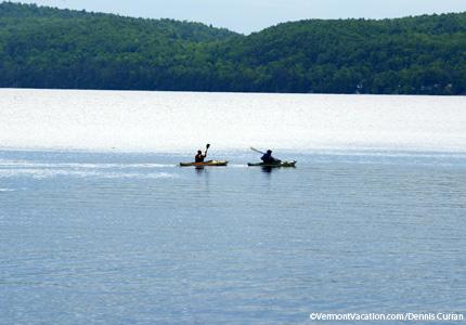 Paddle kayaks down Lake Champlain in Burlington, Vermont