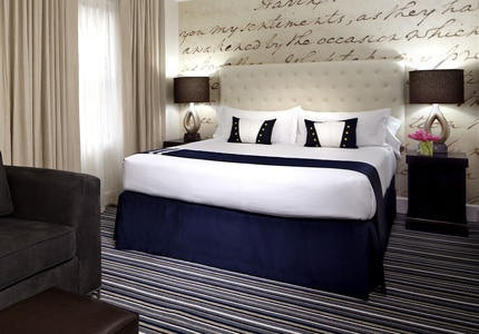 A guest room at The George, A Kimpton Hotel in Washington, D.C.