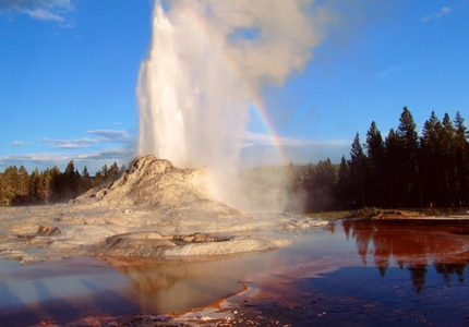 Old Faithful Geyser at Yellowstone National Park, one of GAYOT's Top 10 U.S. National Parks