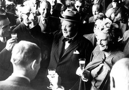 Even politicians need to let loose sometimes; here Sir Winston Churchill toasts with Champagne