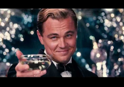 In a scene from the 2013 version of Fitzgerald's The Great Gatsby, Leonardo Dicaprio makes a toast with Champagne