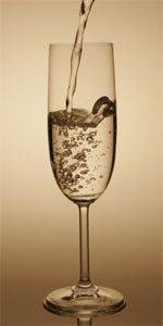 The classic Champagne pouring method dissolves CO2 faster