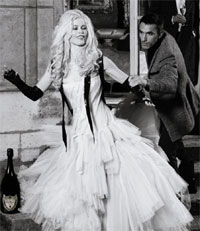Supermodel Claudia Schiffer dressed in a wedding gown in this exclusive photo by Karl Lagerfeld for Dom Perignon