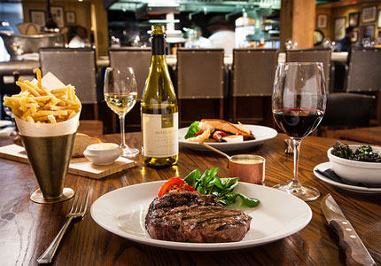 No steak dinner is complete without a rich wine to complement your cut (Photo courtesy of Flickr user Hotel du Vin & Bistro)