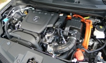 The 1.5-liter 4-cylinder engine of a 2013 Acura ILX Hybrid