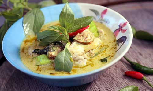 Tom kha kai is a spicy and sour hot soup