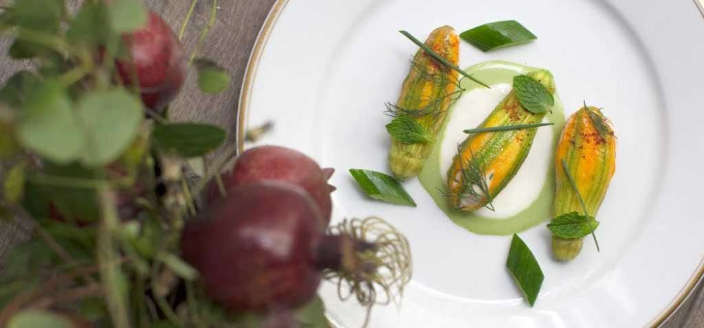 Lobster stuffed squash blossoms by chef Daniel Rose at Le Coucou, NYC (Photo by Corry Arnold)