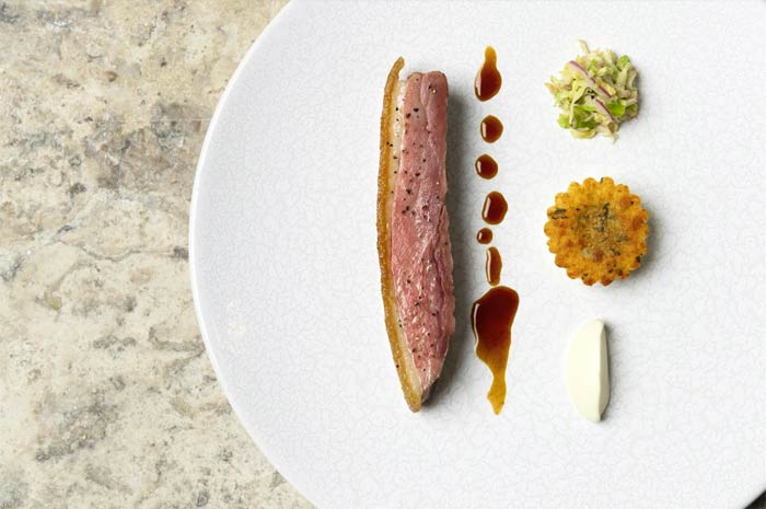 Gabriel Kreuther: Long Island duck breast smoked in hay