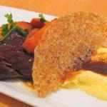72-hour braised short rib with polenta and Syrah sauce