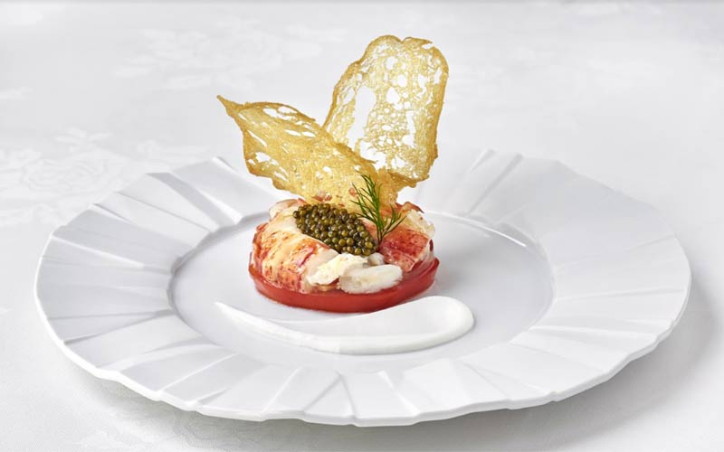 The Inn at Little Washington: Medallions of chilled lobster with imperial osetra caviar on a raft of garden tomato with horseradish cream